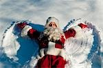 Santa making a snow angel in fresh snow Stock Photo - Premium Rights-Managed, Artist: AlaskaStock, Code: 854-03362345