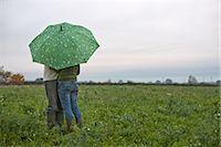 couple under umbrella in field Stock Photo - Premium Royalty-Freenull, Code: 649-03362798