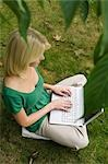 girl on computer in garden Stock Photo - Premium Royalty-Free, Artist: AWL Images, Code: 649-03362975