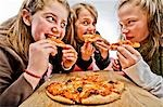 3 teenagers eating pizza Stock Photo - Premium Royalty-Free, Artist: RW Photographic, Code: 649-03363182