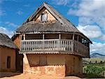 A typical double-storied Malagasy highland house with a carved balcony. Stock Photo - Premium Rights-Managed, Artist: AWL Images, Code: 862-03364007