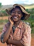 A happy Malagasy young woman despite her clothes which underscore her poverty. Stock Photo - Premium Rights-Managed, Artist: AWL Images, Code: 862-03364015