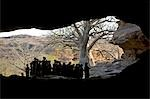Mali,Dogon Country. Children gather at the entrance to Bongo tunnel which is a natural rock formation near Sangha,an attractive Dogon village built among rocks on top of the Bandiagara escarpment. Stock Photo - Premium Rights-Managed, Artist: AWL Images, Code: 862-03364188