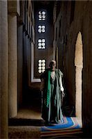 Mali,Niger Inland Delta. The imam of Kotaka pauses beside an archway inside the impressive Sudan-style mosque which dominates Kotaka village on the banks of the Niger River. Stock Photo - Premium Rights-Managednull, Code: 862-03364267