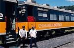 Guard and chef stand by the train at Divisadero Station on the Chihuahua-Pacifico Railway. Stock Photo - Premium Rights-Managed, Artist: AWL Images, Code: 862-03364375