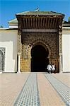 Two children leave through the entrance to the Mausoleum of Moulay Ismail in Meknes,Morocco. Moulay Ismail made Meknes his capital when he became sultan in the 17th century. Stock Photo - Premium Rights-Managed, Artist: AWL Images, Code: 862-03364628
