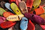 Brightly coloured Moroccan slippers (known as babouche) for sale in the Souq of the Quartier Habous or New Medina in Casablanca.