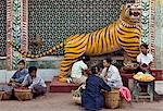 Myanmar. Burma. Popa. Food and flower sellers beside a statue of a tiger at the foot of Mount Popa. Stock Photo - Premium Rights-Managed, Artist: AWL Images, Code: 862-03365127