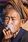 Myanmar,Burma,Lake Inle. An old Pa-O woman smokes a cheroot. Stock Photo - Premium Rights-Managed, Artist: AWL Images, Code: 862-03365179