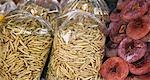 Myanmar,Burma,Kengtung. A stall at Kengtung market offers for sale dried fruit and packets of fried bamboo worms which are palatable when crisp. Stock Photo - Premium Rights-Managed, Artist: AWL Images, Code: 862-03365212
