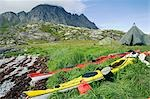 Norway,Nordland,Helgeland. A kayak expedition camps in the shadow of a coastal mountain Stock Photo - Premium Rights-Managed, Artist: AWL Images, Code: 862-03365645