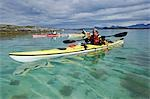 Norway,Nordland,Helgeland. Summer water sports in Norway - sea kayaking down up the coast of Norway with cystal clear waters and mountains in the background. Stock Photo - Premium Rights-Managed, Artist: AWL Images, Code: 862-03365680
