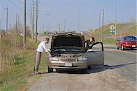 stalled car - Man and Woman With Car Trouble Looking Under the Hood Stock Photo - Premium Royalty-Freenull, Code: 600-03365738