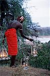 Service in the bush - kerosene lanterns light the pathway to your tent on a mobile safari. Stock Photo - Premium Rights-Managed, Artist: AWL Images, Code: 862-03365960