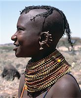 A young Turkana girl has had the rims of her ears pierced in seven places and keeps the holes open with small wooden sticks. After marriage,she will hang leaf-shaped metal pendants from each hole. Stock Photo - Premium Rights-Managednull, Code: 862-03366112