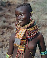 A young Turkana girl adorned with necklaces of a style the Southern Turkana prefer to wear. Stock Photo - Premium Rights-Managednull, Code: 862-03366113