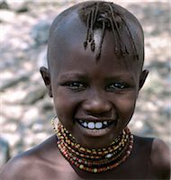 A young Turkana girl with her head shaved except for a tuft,which is braided. This is the usual hairstyle for women and girls. Stock Photo - Premium Rights-Managednull, Code: 862-03366122