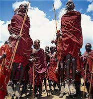 During their dances,Maasai warriors take turns to leap high in the air from a standing position without bending their knees. They achieve this by flexing their ankles in a seemingly effortless way . Stock Photo - Premium Rights-Managednull, Code: 862-03366158