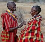 Two Maasai women in traditional attire chat to each other. Stock Photo - Premium Rights-Managed, Artist: AWL Images, Code: 862-03366169
