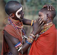 Young Maasai girls decorate their faces with ochre and clay in preparation for a dance. Stock Photo - Premium Rights-Managed, Artist: AWL Images, Code: 862-03366173