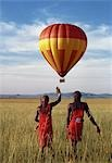 Two Maasai warriors watch a hot air balloon flight over Masai Mara. Stock Photo - Premium Rights-Managed, Artist: AWL Images, Code: 862-03366241