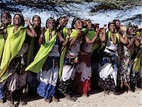 Gabbra women sing and dance to celebrate a wedding. The traditional metal ornamentation on their heads is called malmal. Stock Photo - Premium Rights-Managednull, Code: 862-03366405