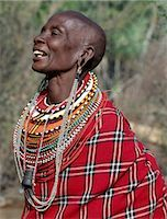 A Samburu woman singing. The strings of black and white beads hanging from her ears signify that she has two grown-up sons who are warriors of the tribe. Note: the traditional horn snuff container hanging from her neck. Stock Photo - Premium Rights-Managednull, Code: 862-03366590
