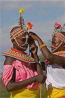 Two young Samburu girls help each other preparing for a celebration,Wamba District,Kenya Stock Photo - Premium Rights-Managednull, Code: 862-03366627