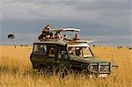 Kenya,Masai Mara National Reserve. Family on a game drive in a Toyota Landcruiser in the open grassy plains of the Masai Mara. Stock Photo - Premium Rights-Managed, Artist: AWL Images, Code: 862-03366883
