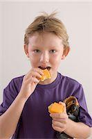 Boy Eating Cheese Stock Photo - Premium Royalty-Freenull, Code: 600-03368373
