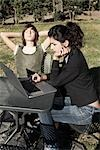 Woman and Boy Sitting Outdoors Using Laptop Computer Stock Photo - Premium Rights-Managed, Artist: Siephoto, Code: 700-03368493