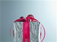 Christmas gift with red ribbon and silver wrapping Stock Photo - Premium Royalty-Freenull, Code: 635-03372964