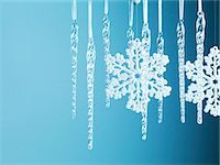 Snowflake and icicle Christmas ornaments hanging from string Stock Photo - Premium Royalty-Freenull, Code: 635-03372987