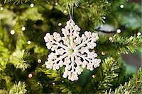 Snowflake Christmas ornament on tree Stock Photo - Premium Royalty-Freenull, Code: 635-03373022