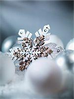 snowflakes  holiday - Close up of snowflake Christmas ornament Stock Photo - Premium Royalty-Freenull, Code: 635-03373047