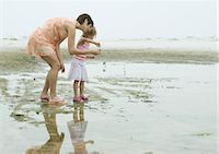 Mother and daughter on beach, full length Stock Photo - Premium Royalty-Freenull, Code: 695-03373517