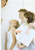 Children giving woman mother's day surprise Stock Photo - Premium Royalty-Freenull, Code: 695-03373765