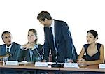 Businesspeople in committee meeting, one man standing Stock Photo - Premium Royalty-Free, Artist: AWL Images, Code: 695-03374196