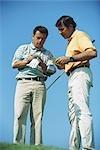 Two golfers, noting score, full length Stock Photo - Premium Royalty-Free, Artist: Natasha V, Code: 695-03374631