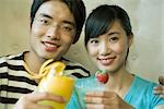 Young couple holding cocktails, clinking glasses Stock Photo - Premium Royalty-Free, Artist: Masterfile, Code: 695-03375079