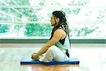 Man sitting in lotus position, side view