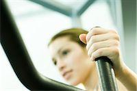 Woman using weight machine Stock Photo - Premium Royalty-Freenull, Code: 695-03375149