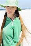 Young woman with long hair wearing sun hat on beach, waist up Stock Photo - Premium Royalty-Free, Artist: Jean-Christophe Riou, Code: 695-03375349