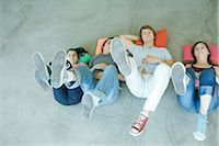female 16 year old feet - Four teen friends lying on backs on floor, holding up legs, focus on soles of shoes Stock Photo - Premium Royalty-Freenull, Code: 695-03375665