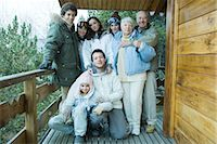 Mixed age group standing on deck in snow, group portrait, full length Stock Photo - Premium Royalty-Freenull, Code: 695-03376152