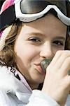 Girl wearing ski gear, drinking from bottle, close-up Stock Photo - Premium Royalty-Freenull, Code: 695-03376388
