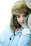 Preteen girl wearing fur hat and winter jacket, smiling at camera, portrait Stock Photo - Premium Royalty-Freenull, Code: 695-03376419