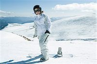 Teenage girl standing with snowboard, smiling at camera, full length portrait Stock Photo - Premium Royalty-Freenull, Code: 695-03376445