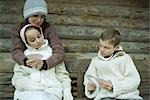Young friends in winter clothes playing cards Stock Photo - Premium Royalty-Free, Artist: John Gertz, Code: 695-03376549