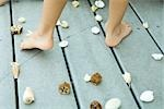 Child standing among seashells, cropped view of feet Stock Photo - Premium Royalty-Free, Artist: GreatStock, Code: 695-03379329